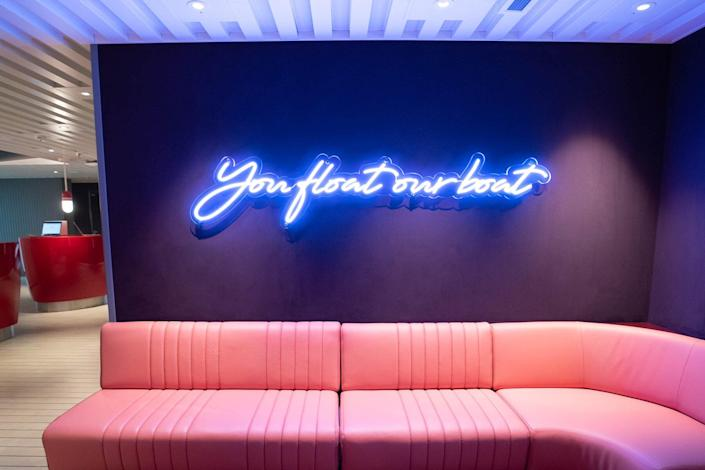 'You Float Our Boat' neon sign in Sailor Services.