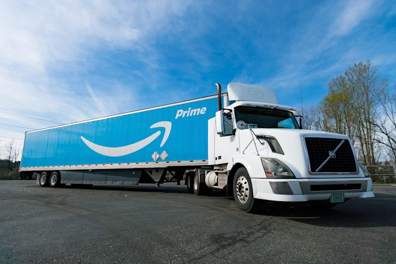 A large tractor-trailer truck with the Amazon Prime logo emblazoned on the side.