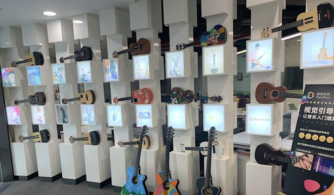 An exhibition wall in Popumusic's Shenzhen headquarters showing Poputar and Populele models. Photo: Handout