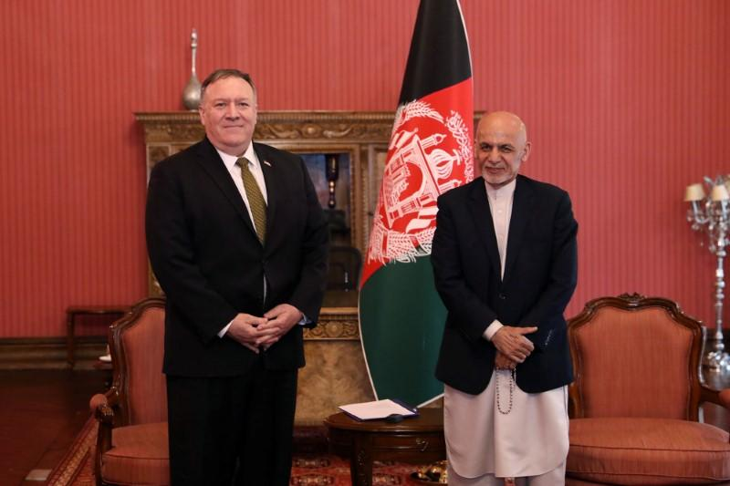 Afghanistan's President Ashraf Ghani and U.S. Secretary of State Mike Pompeo, pose for a photo during their meeting in Kabul