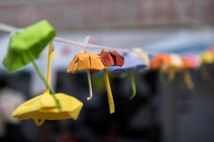 A collection of small origami umbrellas -- symbols of the democracy movement in Hong Kong -- are hung on a line in Hong Kong on October 14, 2014 (AFP Photo/Alex Ogle)