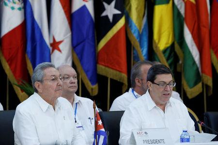 Cuba's President Raul Castro listens to Cuba's Foreign Minister Bruno Rodriguez during the opening of the Association of Caribbean States meeting in Havana