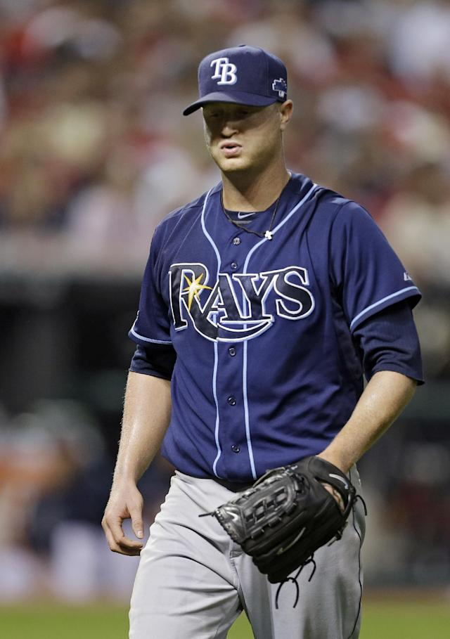 Tampa Bay Rays starting pitcher Alex Cobb heads to the dugout after retiring the Cleveland Indians in order in the sixth inning of the AL wild-card baseball game Wednesday, Oct. 2, 2013, in Cleveland. (AP Photo/Tony Dejak)