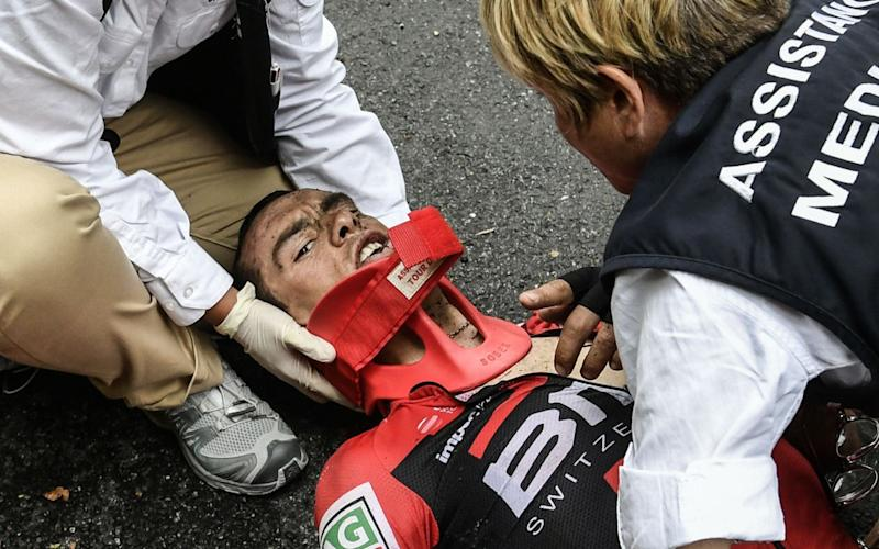 Richie Porte left the Tour de France in an ambulance after crashing during stage nine - AFP