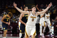 Minnesota's Liam Robbins (0) celebrates his three-point shot against Michigan in the second half of an NCAA college basketball game, Saturday, Jan. 16, 2021, in Minneapolis. (AP Photo/Jim Mone)
