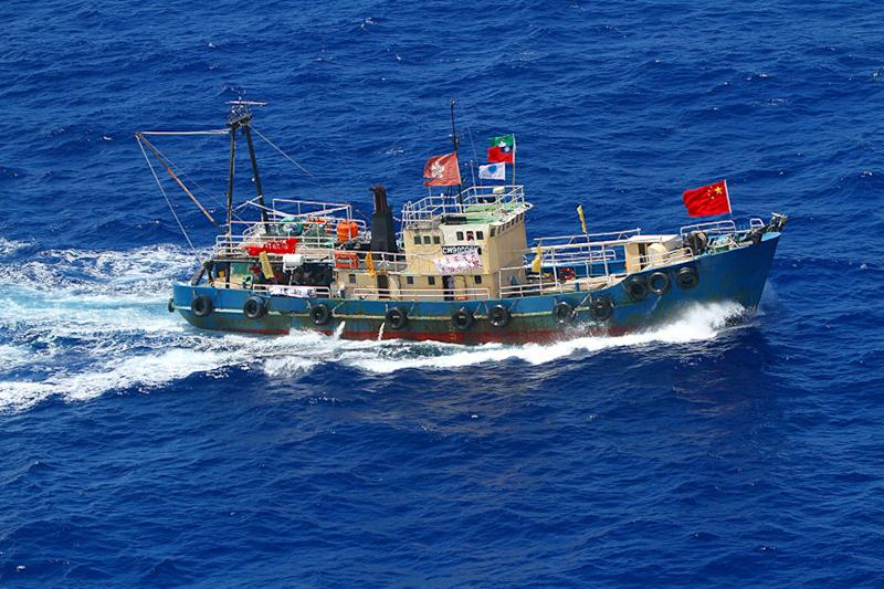 In this photo provided by Japan Coast Guard, a Hong Kong fishing boat sails in the water, 52 kilometers (32 miles) west of the Uotsuri Island, one of the islands of Senkaku in Japanese and Diaoyu in Chinese, in East China Sea, Wednesday, Aug. 15, 2012. Hong Kong activists trying to reach the disputed islands claimed by Japan, China and Taiwan said Wednesday that they were being tailed by Japanese government ships trying to stop them, as territorial disputes continue to raise tensions among Asian powerhouses. (AP Photo/Japan Coast Guard) EDITORIAL USE ONLY