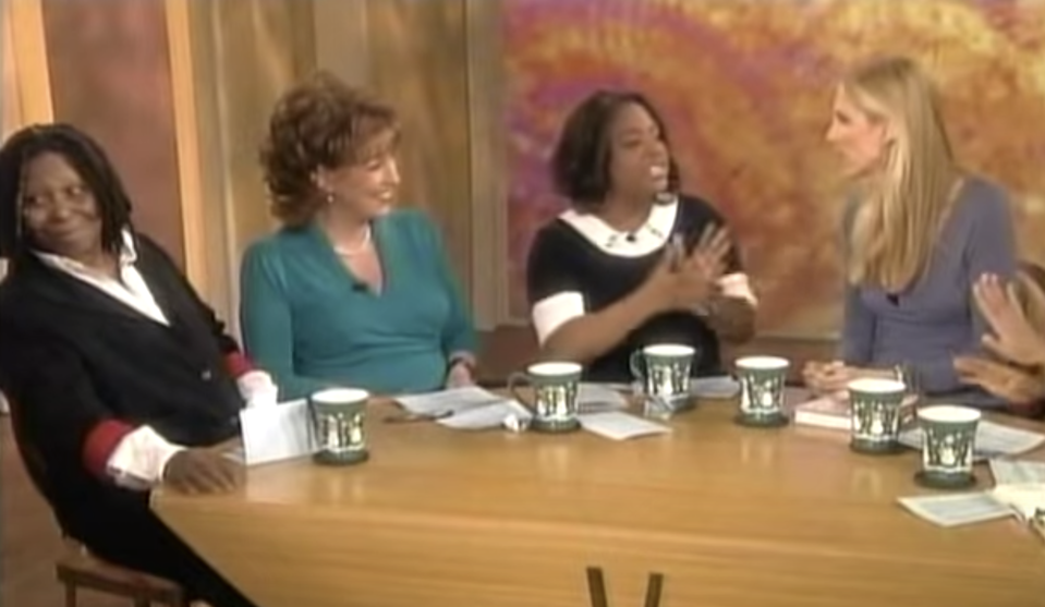 ann coulter on the view, with some hosts engaging and whoopi goldberg looking away in confusion
