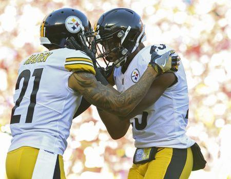 Oct 15, 2017; Kansas City, MO, USA; Pittsburgh Steelers safety Robert Golden (21) and safety Mike Mitchell (23) celebrate in the first half of the game against the Kansas City Chiefs at Arrowhead Stadium. Mandatory Credit: Jay Biggerstaff-USA TODAY Sports