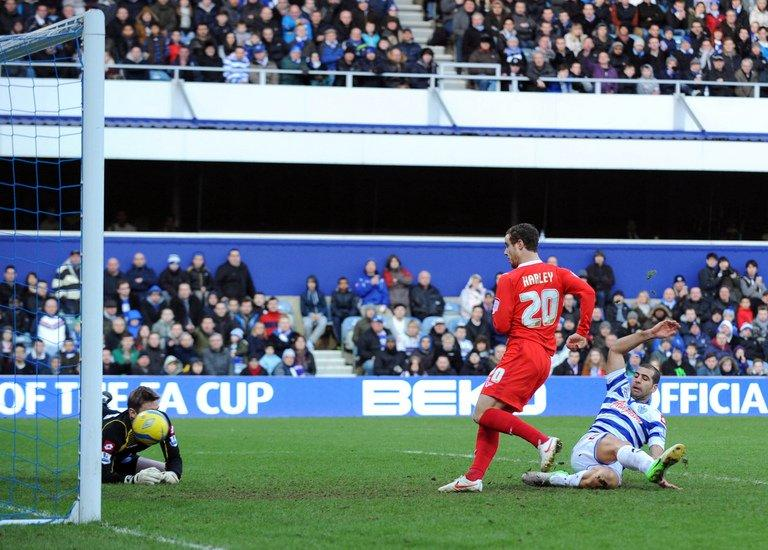 MK Dons' Ryan Harley scores against Queens Park Rangers on January 26, 2013