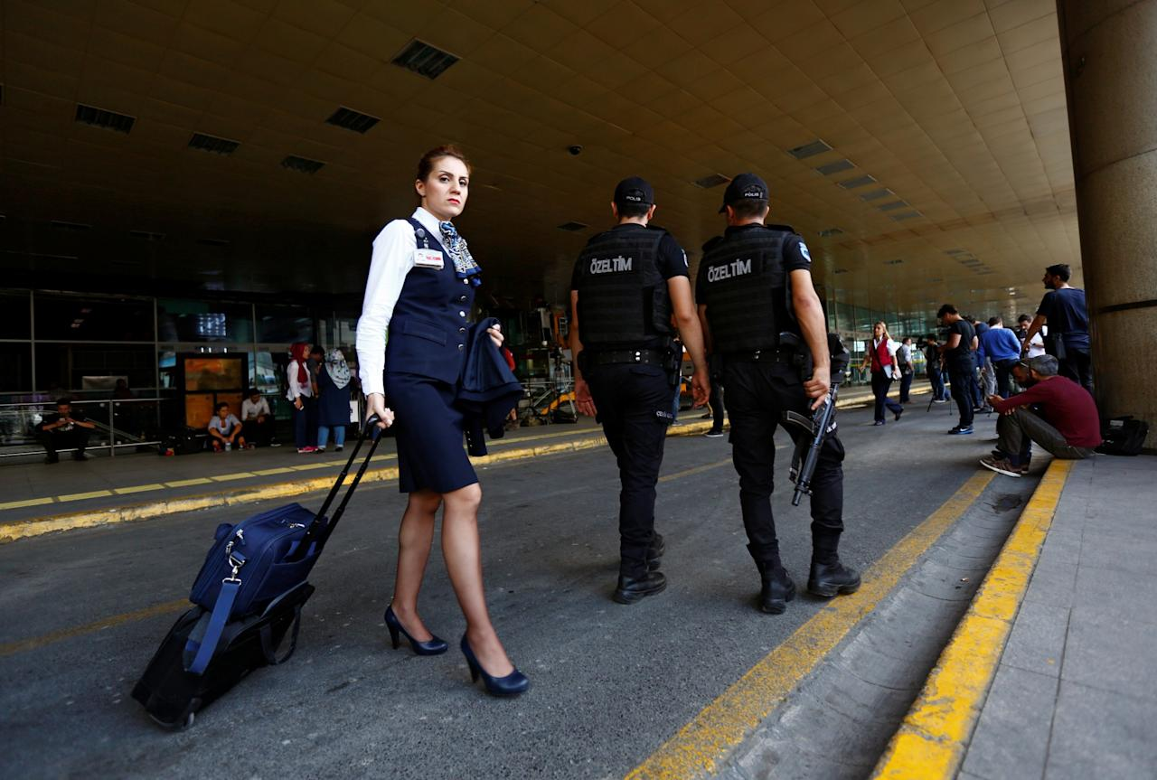 <p>Police officers patrol as a flight attendant leaves the country's largest airport, Istanbul Ataturk, following yesterday's blast in Istanbul, Turkey, June 29, 2016. (REUTERS/Murad Sezer) </p>