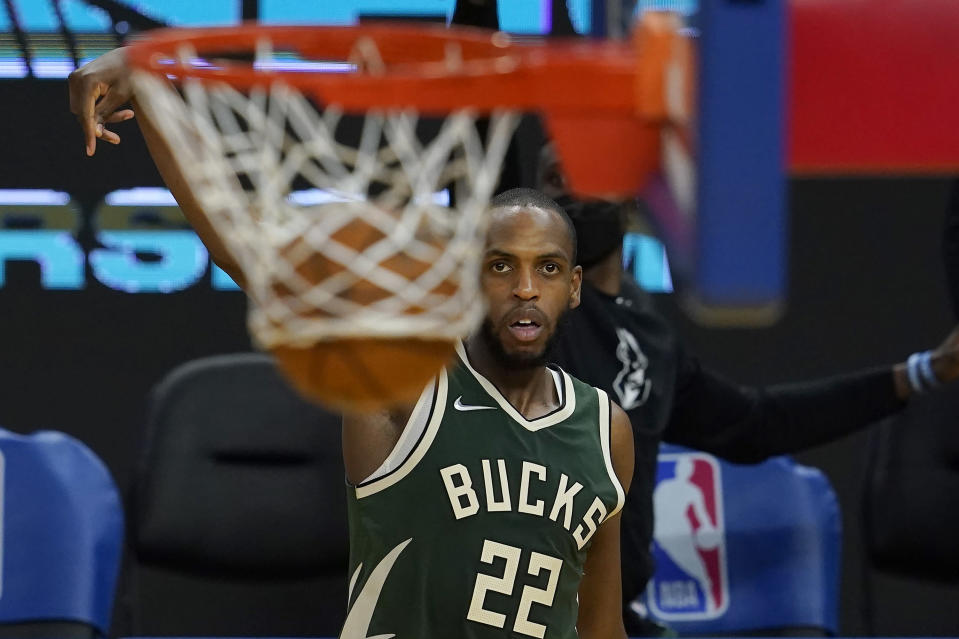 Milwaukee Bucks forward Khris Middleton (22) watches his 3-point basket during the second half of an NBA basketball game against the Golden State Warriors in San Francisco, Tuesday, April 6, 2021. (AP Photo/Jeff Chiu)