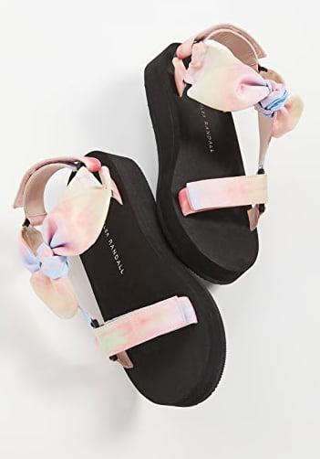 "<p>This is a sporty classic with a feminine twist.</p> <p><a href=""https://www.popsugar.com/buy/Loeffler-Randall-Maisie-Sport-Sandals-573105?p_name=Loeffler%20Randall%20Maisie%20Sport%20Sandals&retailer=shopbop.com&pid=573105&price=195&evar1=fab%3Aus&evar9=47446893&evar98=https%3A%2F%2Fwww.popsugar.com%2Ffashion%2Fphoto-gallery%2F47446893%2Fimage%2F47463173%2FLoeffler-Randall-Maisie-Sport-Sandals&list1=sandals%2Cshoes%2Ctrends%2Csummer%2Cloeffler%20randall%2Cfashion%20shopping&prop13=mobile&pdata=1"" class=""link rapid-noclick-resp"" rel=""nofollow noopener"" target=""_blank"" data-ylk=""slk:Loeffler Randall Maisie Sport Sandals"">Loeffler Randall Maisie Sport Sandals</a> ($195)</p>"