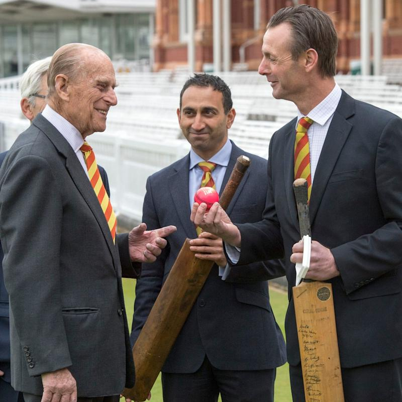 The Duke of Edinburgh (second left) is shown a number of bats by Dr Chinmay Gupte (second right) and John Stephenson (right), during a visit to Lord's cricket ground - Credit: Arthur Edwards/PA Wire