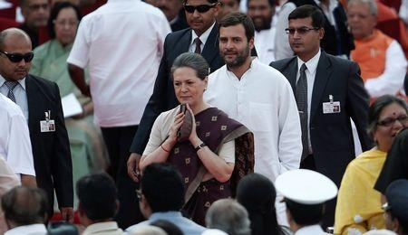India's Congress party chief Sonia Gandhi and her son and lawmaker Rahul Gandhi arrive to attend Prime Minister Modi's oath-taking ceremony at the presidential palace in New Delhi