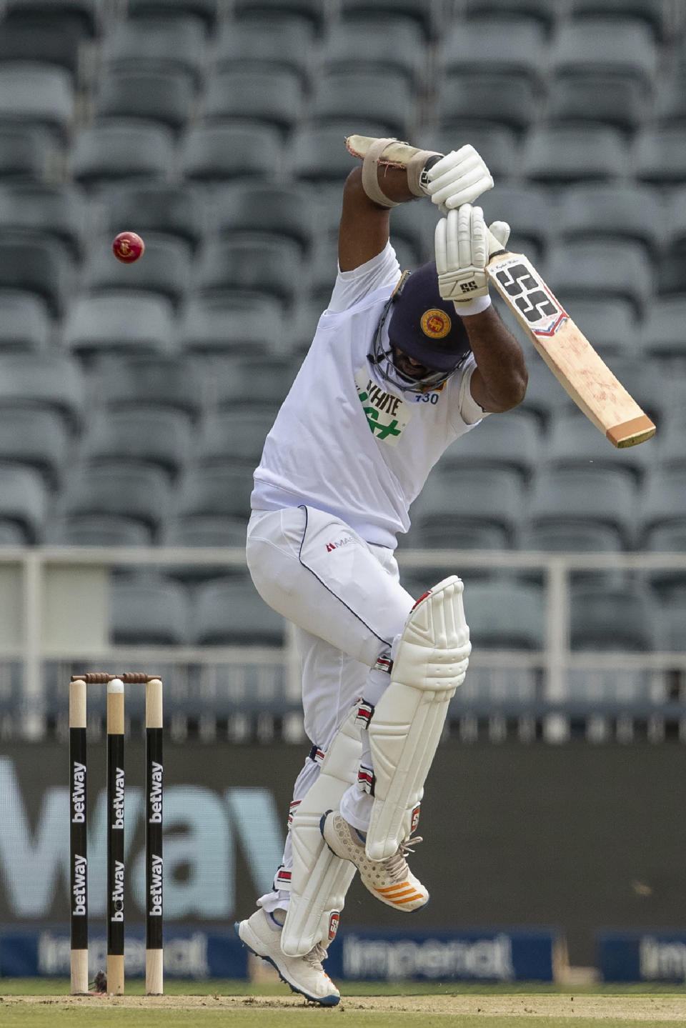 CORRECTS BATSMAN'S NAME - Sri Lanka's batsman Kusal Perera evades a rising delivery South Africa's bowler Anrich Nortje during the 2nd Test cricket match between South Africa and Sri Lanka in Johannesburg, South Africa, Sunday, Jan. 3, 2021. (AP Photo/Themba Hadebe)