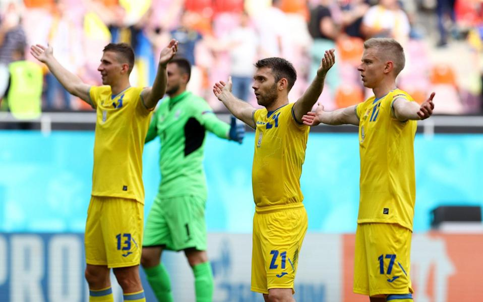 Ukraine players celebrate after the match - Reuters