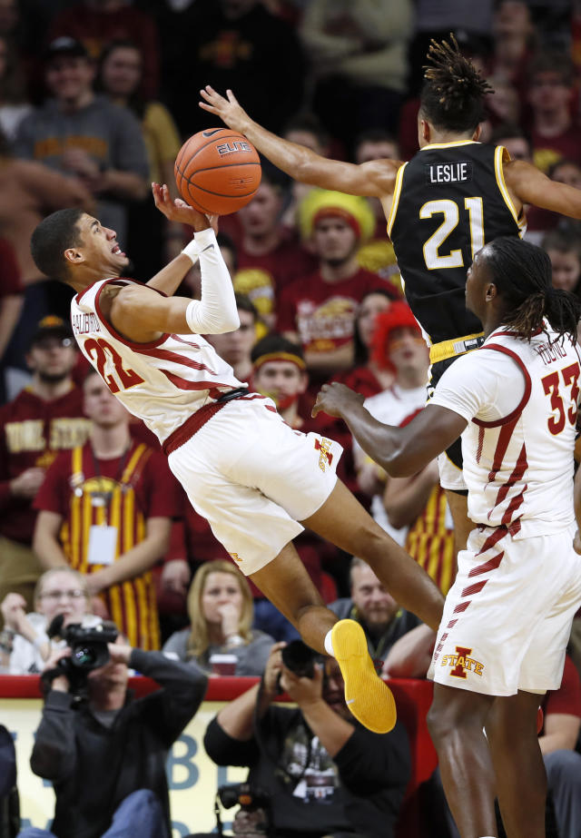 Iowa State guard Tyrese Haliburton, left, is fouled by Southern Mississippi guard Auston Leslie (21) during the second half of an NCAA college basketball game, Tuesday, Nov. 19, 2019, in Ames, Iowa. Iowa State won 73-45. (AP Photo/Charlie Neibergall)