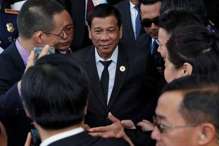 Philippines' President Rodrigo Duterte leaves the APEC CEO summit in Danang