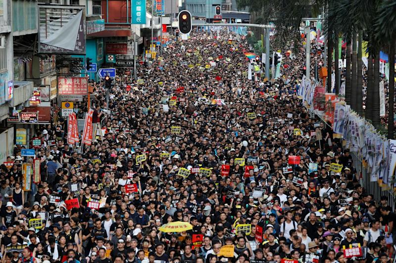Anti-extradition bill protesters march on July 1, the anniversary of Hong Kong's handover from the UK to China.