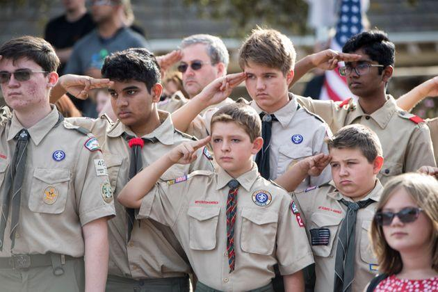 WESTLAKE VILLAGE, CA - NOVEMBER 15: Boy Scouts salute in honor of Ventura County Sheriff Sgt. Ron Helus on the street outside of Pierce Brothers Valley Oaks Memorial Park, on November 15, 2018, in Westlake, California.  Sgt. Helus was fatally wounded while engaging an active shooter at the Borderline Bar and Grill in Thousand Oaks, California on November 7.  (Photo by Hans Gutknecht/Digital First Media/Los Angeles Daily News via Getty Images) (Photo: MediaNews Group via MediaNews Group via Getty Images)