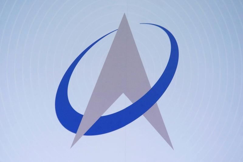 FILE PHOTO: The company logo of AAC Technologies Holdings Inc is displayed at a news conference in Hong Kong