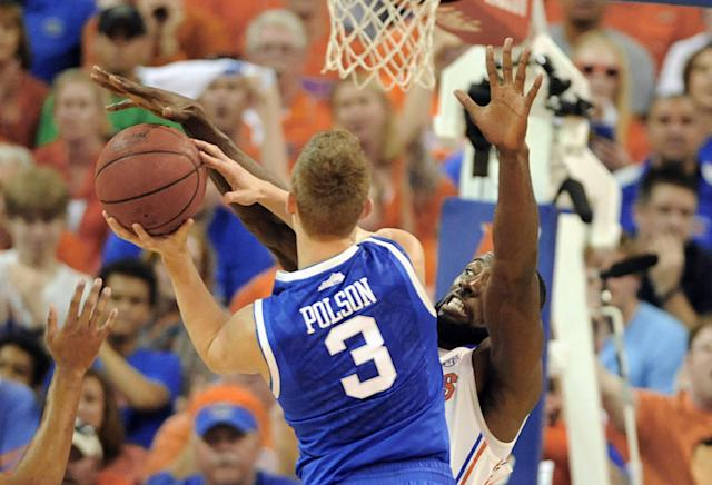 Florida center Patric Young (4) blocks a shot by Kentucky guard Jarrod Polson (3) during the first half of an NCAA college basketball game Saturday, March 8, 2014, in Gainesville, Fla. (AP Photo/Phil Sandlin)