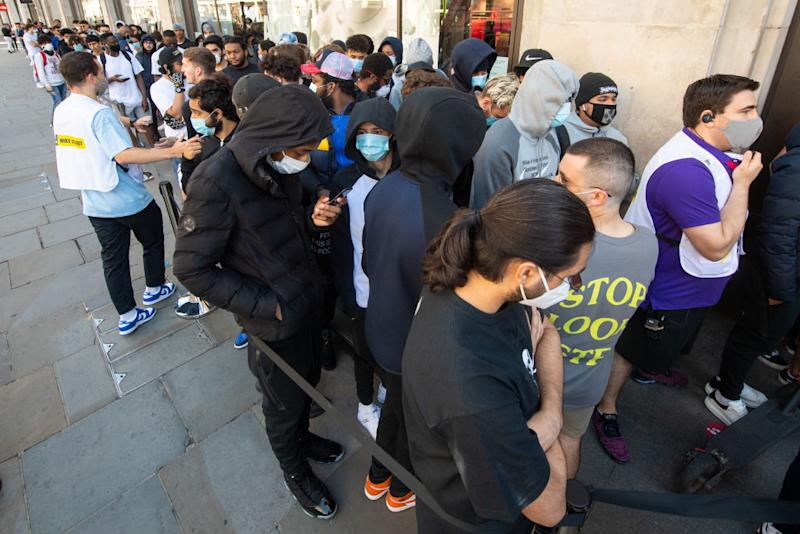 People queue outside Nike Town at Oxford Street, London, as non-essential shops in England open their doors to customers for the first time since coronavirus lockdown restrictions were imposed in March.
