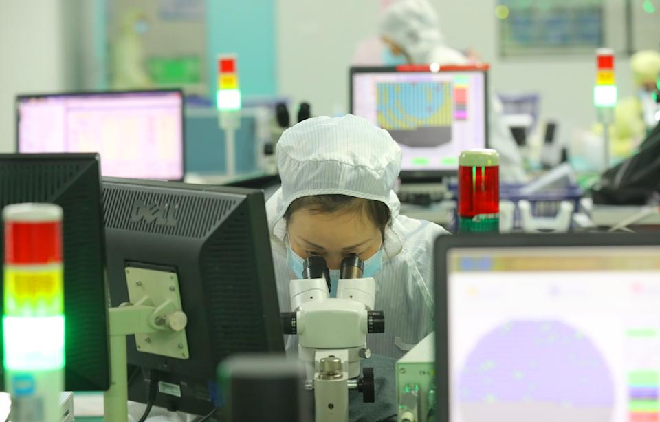 NANTONG, CHINA - MARCH 17 2021: An employee works at Jiejie Microelectronics, a manufacturer of semiconductors, in Nantong in east China's Jiangsu province Wednesday, March 17, 2021. (Photo credit should read Feature China/Barcroft Media via Getty Images)