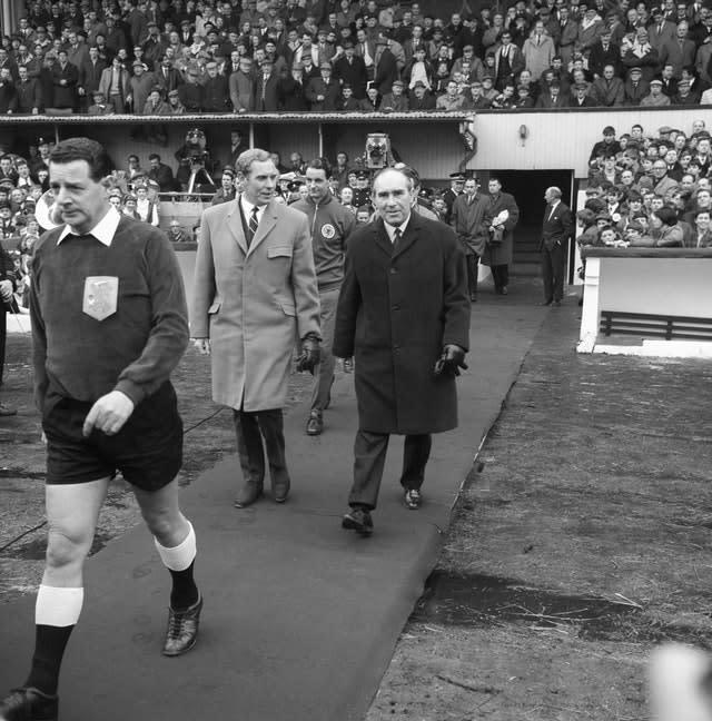 Bobby Brown, left, walks out with England manager Alf Ramsey (PA)