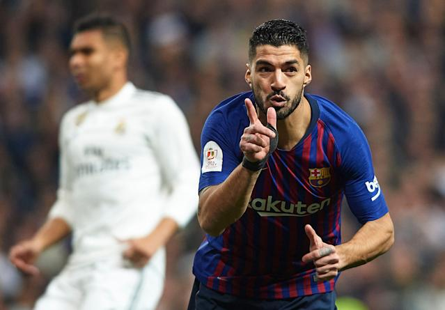 "Luis Suarez scored two goals as opportunistic <a class=""link rapid-noclick-resp"" href=""/soccer/teams/barcelona/"" data-ylk=""slk:Barcelona"">Barcelona</a> beat its bitter rival in the Spanish capital. (Getty)"