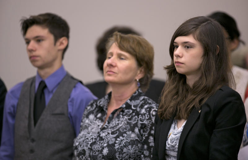 Nicole Maines, right, stands with her brother Jonas Maines, and her mother, Kelly Maines, during a hearing before the Maine Supreme Court, Wednesday, June 12, 2013, in Bangor, Maine. A lawsuit accuses a school district of breaking a state law in 2007 when it stopped letting Nicole Maines use the girls bathroom and required to her use a staff bathroom after a student's grandfather complained. (AP Photo/Robert F. Bukaty)