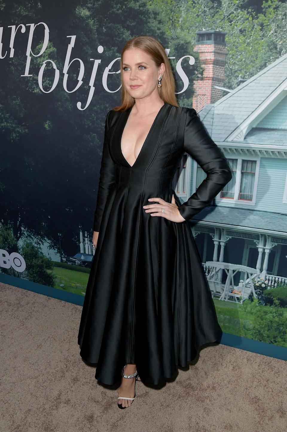 <p>On June 26, Amy Adams attended the premiere of 'Sharp Objects' at The Cinerama Dome. For the red carpet event, the actress opted for a long-sleeved Calvin Klein dress accessorised with Cartier jewellery. <em>[Photo: Getty]</em> </p>