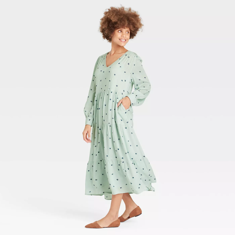 """<h2>A New Day Long Sleeve Tiered Dress</h2><br><strong><em>The Go Big Or Go Home</em></strong><br><br>Care to waft around your neighborhood this summer in a cloud of style, romance, and lightweight, minty-green fabric? If so, Target has the dress for you — reviewers praised this frock's easy fit, soft handfeel, and flattering drape.<br><br><strong>The Hype: </strong>4 out of 5 stars; 173 reviews on Target.com<br><br><strong>What They're Saying: </strong>""""I absolutely LOVE THIS DRESS!!! It's got such a feminine quality to it and the billowy sleeves ... very romantic looking. If you're looking for a form fitting body con type dress .... THIS IS NOT FOR YOU. This dress though it's a bit oversized, it's flattering on all sizes and shapes. I'd only recommend ordering smaller than your usual size because it does run big. I'm 5' 5, 110 lbs, and the XS was perfect. So pretty on, and for those who like a more cinched waist just add a belt! I love how it hangs and love the softness and comfort of this dress, and pockets too!! It's a keeper for me."""" — D., Target.com reviewer<br><br><em>Shop <strong><a href=""""http://goto.target.com/Ndxj1"""" rel=""""nofollow noopener"""" target=""""_blank"""" data-ylk=""""slk:Target"""" class=""""link rapid-noclick-resp"""">Target</a></strong></em><br><br><strong>A New Day</strong> Long Sleeve Tiered Dress, $, available at <a href=""""https://go.skimresources.com/?id=30283X879131&url=https%3A%2F%2Fgoto.target.com%2Fb3arjx"""" rel=""""nofollow noopener"""" target=""""_blank"""" data-ylk=""""slk:Target"""" class=""""link rapid-noclick-resp"""">Target</a>"""