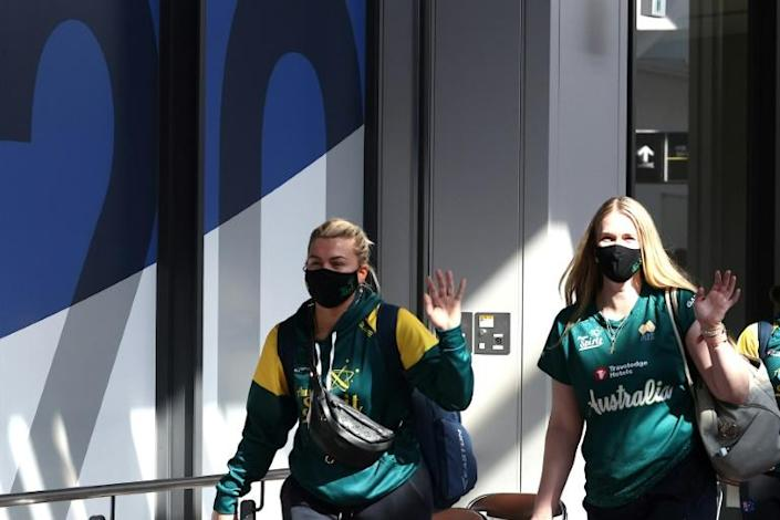 Australia's softball team is the first to arrive for the virus-postponed Olympics
