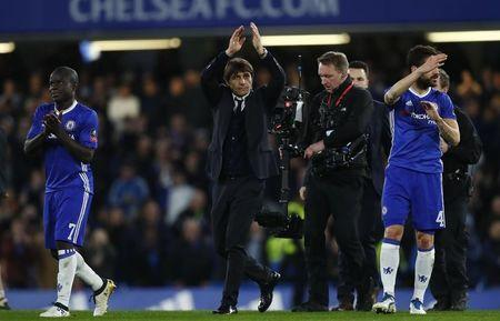 Chelsea manager Antonio Conte applauds their fans after the match