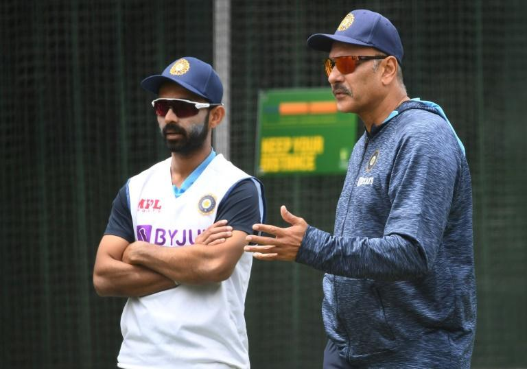 India coach Ravi Shastri talks in the Melbourne nets to Ajinkya Rahane (left) who will captain India in Virat Kohli's absence