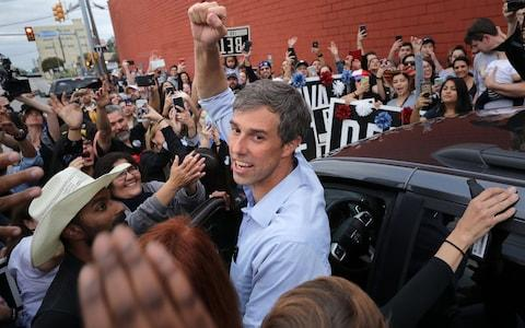 Beto O'Rourke pumps his fist for a cheering crowd before departing a campaign rally at the Alamo City Music Hall - Credit: Chip Somodevilla/Getty Images