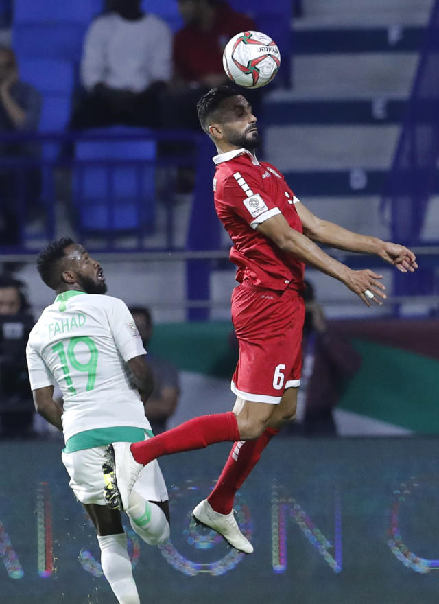 Lebanon's defender Joan Oumari, right, heads the ball against Saudi Arabia's forward Fahad Al Muwallad, left, during the AFC Asian Cup group E soccer match between Lebanon and Saudi Arabia at Al Maktoum Stadium in Dubai, United Arab Emirates, Saturday, Jan. 12, 2019. (AP Photo/Hassan Ammar)
