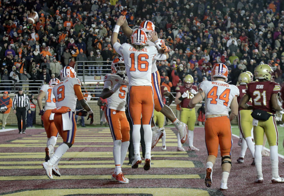Clemson quarterback Trevor Lawrence (16) celebrates his touchdown run with teammates during the second half of an NCAA college football game against Boston College, Saturday, Nov. 10, 2018, in Boston. (AP Photo/Elise Amendola)