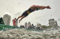 <p>Jaz Hedgeland of Team Australia dives into the water during the Women's Individual Triathlon on day four of the Tokyo 2020 Olympic Games at Odaiba Marine Park on July 27, 2021 in Tokyo, Japan. (Photo by Adam Pretty/Getty Images)</p>