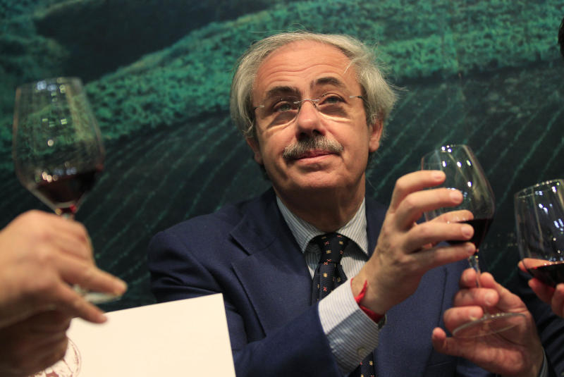 "Sicily region governor Raffaele Lombardo tastes a glass of red wine at the 46th edition of the annual International Wine and Spirits Exhibition ""Vinitaly"", in Verona, northern Italy, Monday, March 26, 2012. ""The companies show that by defeating the Mafia you can begin to legally produce wines, oil and high-quality agricultural goods in the interest of the workers and the producers,"" Sicily's governor Raffaele Lombardo told The Associated Press at Vinitaly on Monday. (AP Photo/Luca Bruno)"