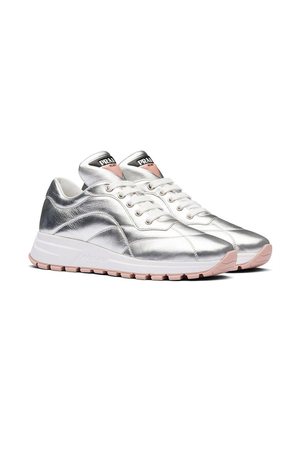 """<p><strong>Prada</strong></p><p>farfetch.com</p><p><strong>$850.00</strong></p><p><a href=""""https://go.redirectingat.com?id=74968X1596630&url=https%3A%2F%2Fwww.farfetch.com%2Fshopping%2Fwomen%2Fprada-metallic-stitched-sneakers-item-14996950.aspx&sref=https%3A%2F%2Fwww.townandcountrymag.com%2Fstyle%2Ffashion-trends%2Fg36544376%2Fbest-metallic-accessories%2F"""" rel=""""nofollow noopener"""" target=""""_blank"""" data-ylk=""""slk:Shop Now"""" class=""""link rapid-noclick-resp"""">Shop Now</a></p><p>Prada sneakers are the ultimate in athleisure style, from the nylon triangle logo to the stitched silver panels. </p>"""