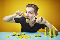 <p>The owner of this record is also known for two other strange eating habits, but here is Andre Ortolf winning the most mustard drunk in 30 seconds with a big mouthful of 416g. (PA) </p>