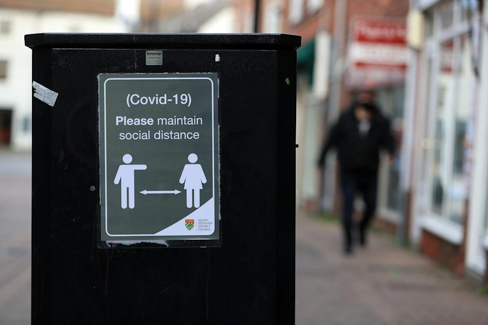 Social distancing signage in Grantham, Lincolnshire, the morning after Prime Minister Boris Johnson ordered a new national lockdown for England which means people will only be able to leave their homes for limited reasons, with measures expected to stay in place until mid-February.