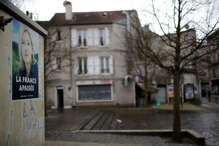 A campaign poster of Marine Le Pen, French National Front political party leader and candidate for French 2017 presidential election, is seen on a wall in Villeneuve Saint-Georges