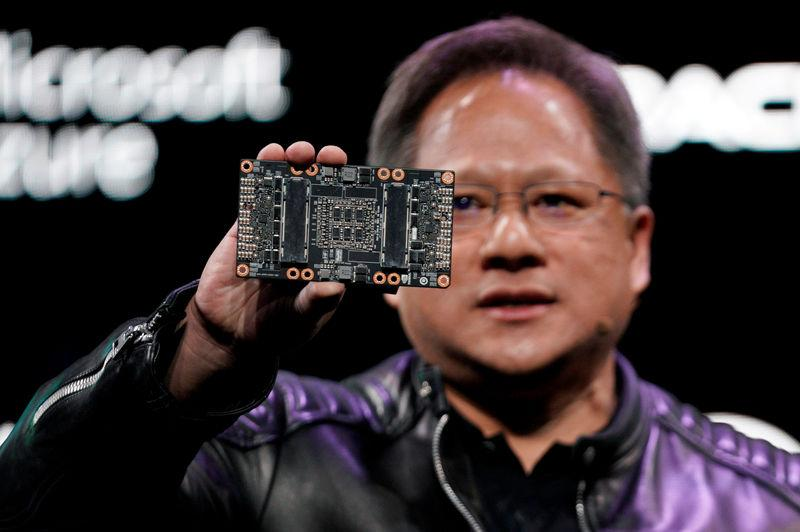 FILE PHOTO: Jensen Huang, CEO of Nvidia, shows the NVIDIA Volta GPU computing platform at his keynote address at CES in Las Vegas