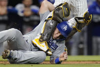 Los Angeles Dodgers' Will Smith is tangled up with San Diego Padres catcher Victor Caratini after getting tagged out during the thirteenth inning of a baseball game Wednesday, Aug. 25, 2021, in San Diego. (AP Photo/Gregory Bull)