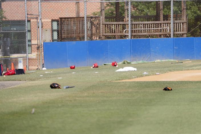 <p>Baseball equipment is seen scattered on the field where a shooting took place at the practice of the Republican congressional baseball team at Eugene Simpson Stadium Park in Alexandria, Va, June 14, 2017. (Photo: Shawn Thew/EPA) </p>