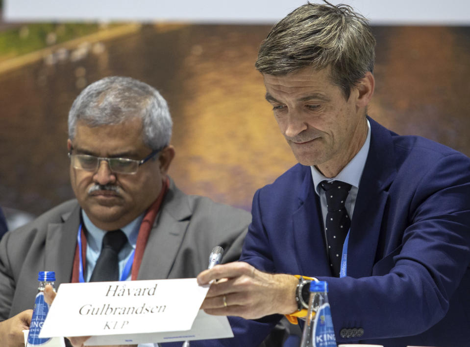 """In this photo taken on Wednesday, Dec. 12, 2018, Norwegian CEO Haavard Gulbrandsen, right and Satya Tripathi attend a debate on """"Aligning financial systems with the climate goals of the Paris agreement"""" during U.N. climate talks of almost 200 nations that are to work out ways of combating global warming, in Katowice, Poland. (AP Photo)"""