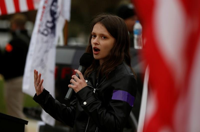 """Activist Sidney Horton addresses militia members and pro-gun rights activists participating in the """"Declaration of Restoration"""" rally in Washington, D.C."""